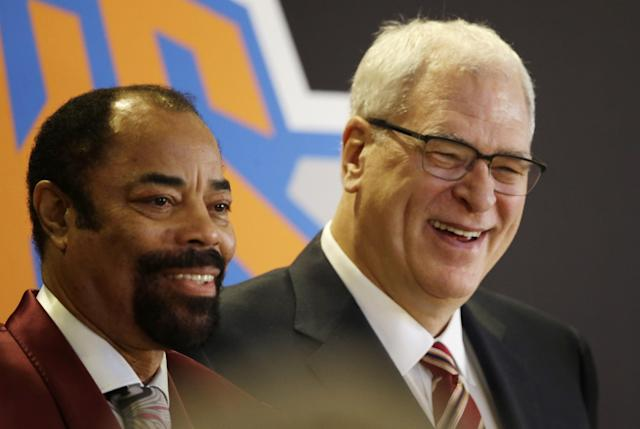 Former New York Knicks player Walt Frazier, left, joins Phil Jackson, the newly named president of the Knicks, at a news conference Tuesday, March 18, 2014 in New York. Frazier and Jackson are former teammates with the Knicks. (AP Photo/Mark Lennihan)