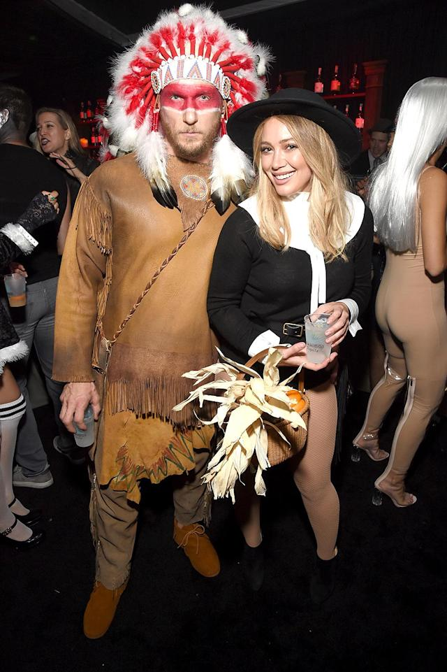 <p>Duff and her new beau, Jason Walsh, were excited to make their first public appearance as a couple, but unfortunately upset many with their politically incorrect, Thanksgiving-themed ensembles. (Photo: Michael Kovac/Getty Images) </p>