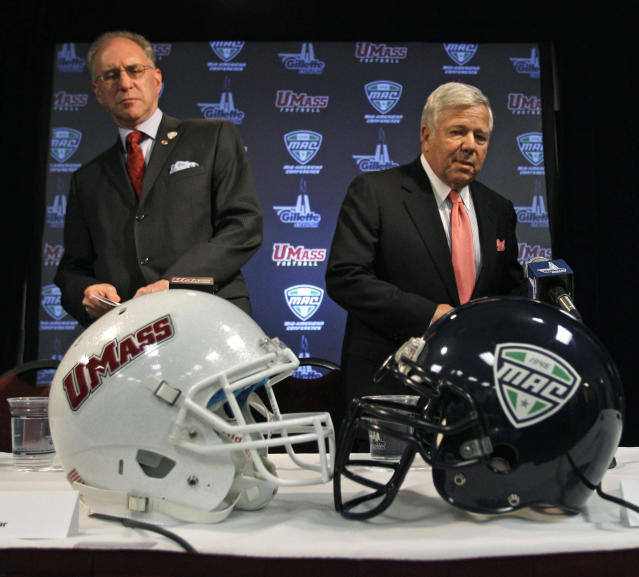 University of Massachusetts Amherst Chancellor Robert Holub, left, arrives with New England Patriots owner Robert Kraft for a news conference where it was announced that the school will switch to the Mid-American Conference, Wednesday, April 20, 2011,at Gillette Stadium in Foxborough, Mass. UMass will play its home games at Gillette Stadium beginning in 2012 and play its first schedule as a full member of the MAC in 2013.(AP Photo/Charles Krupa)