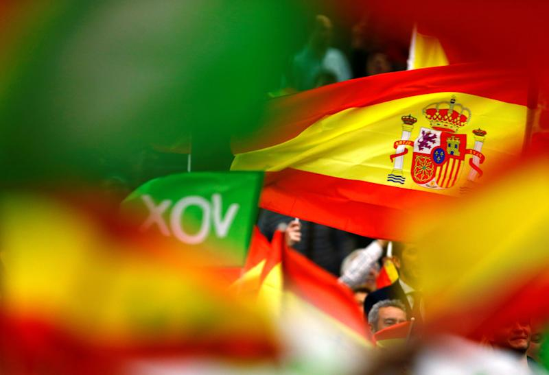 <strong>Spain's far-right party VOX supporters wave Spanish flags during an electoral rally ahead of general elections in the Andalusian capital of Seville, Spain April 24.</strong> (Photo: Marcelo del Pozo / Reuters)