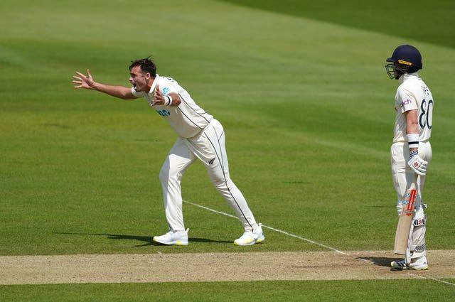 Tim Southee appeals successfully for the wicket of Ollie Pope, right