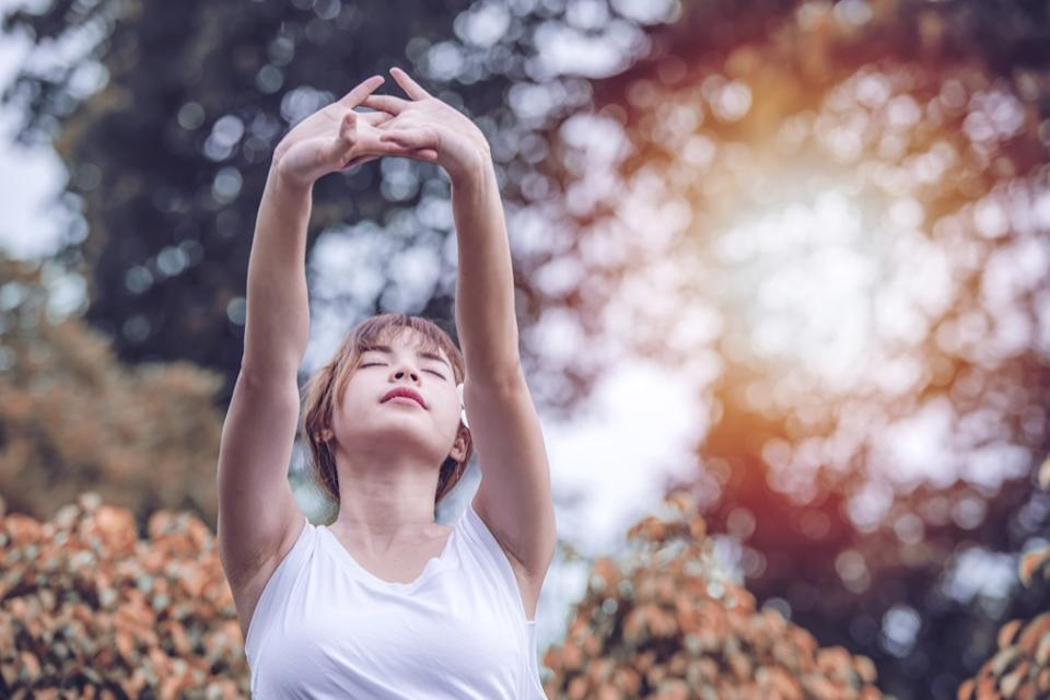 woman breathing and stretching, ways to feel amazing