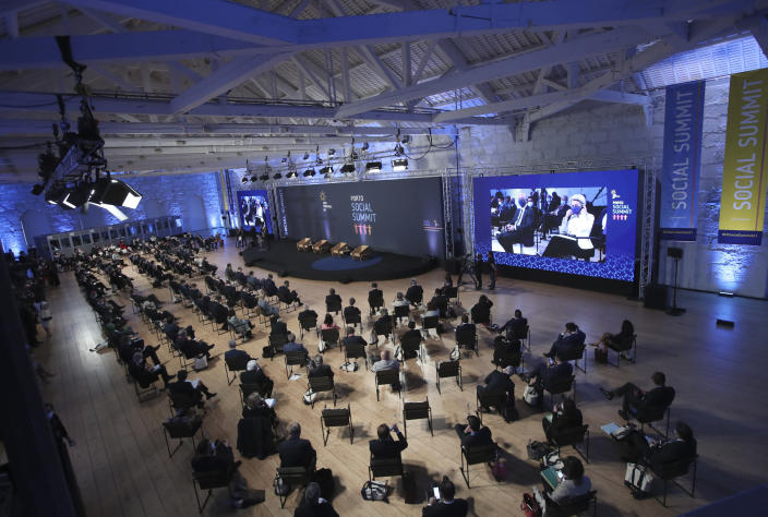 Heads of State and Government attend the opening ceremony of an EU summit at the Alfandega do Porto Congress Center in Porto, Portugal, Friday, May 7, 2021. European Union leaders are meeting for a summit in Portugal on Friday, sending a signal they see the threat from COVID-19 on their continent as waning amid a quickening vaccine rollout. Their talks hope to repair some of the damage the coronavirus has caused in the bloc, in such areas as welfare and employment. (AP Photo/Luis Vieira, Pool)