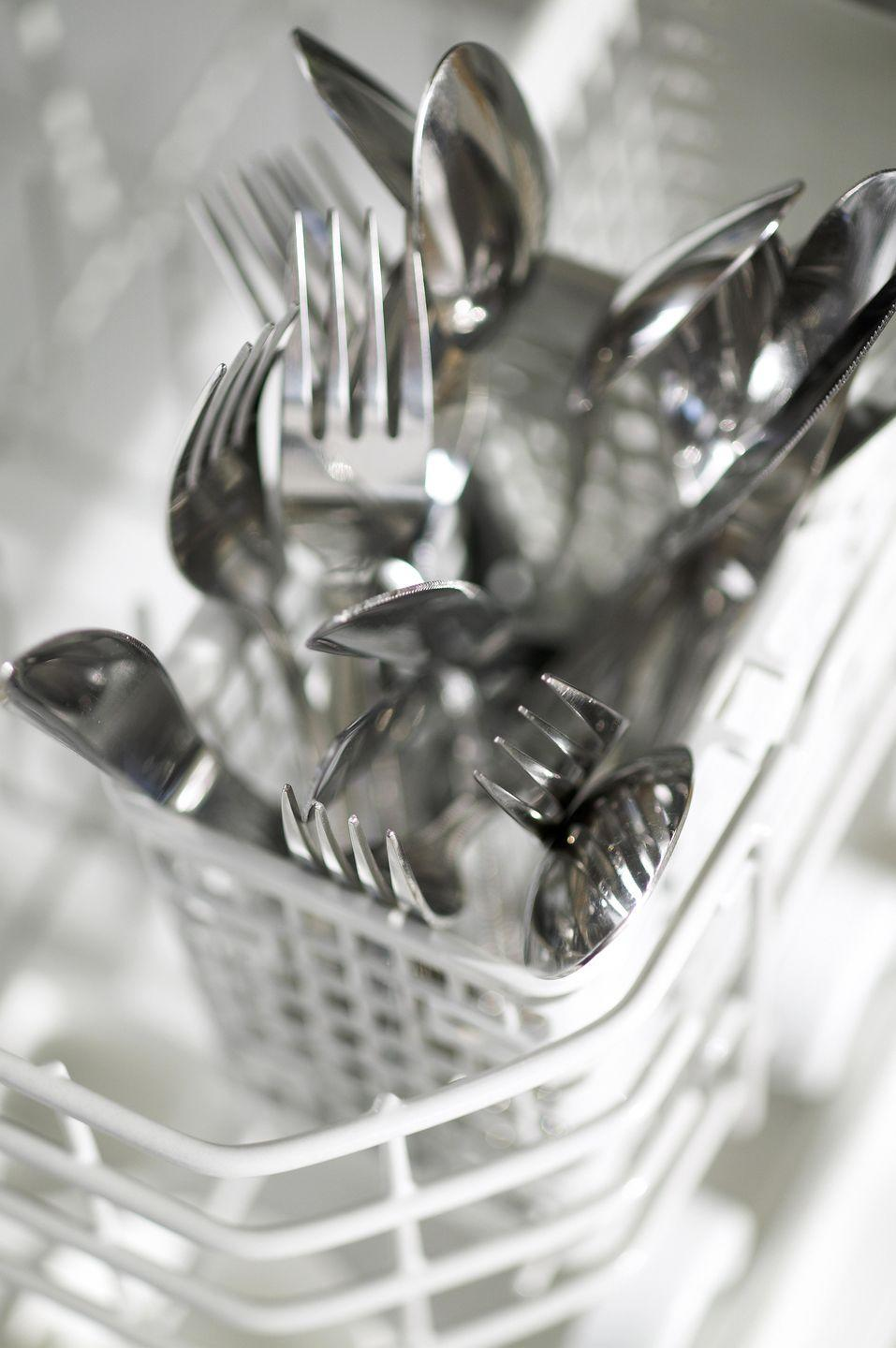 """<p>When you load forks, spoons and knives all facing the same way, they tend to nestle together, which prevents your appliance from doing a thorough wash job. """"Spoons, particularly, can nest in the dishwasher, but when that happens, you rewash them,"""" says Forte. Or, you could load your dishwasher with every other utensil facing the opposite direction.</p>"""