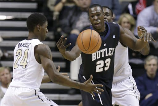 Butler forward Khyle Marshall (23) loses control of the ball as it falls into the hands of Vanderbilt guard Dai-Jon Parker (24) in the first half of an NCAA college basketball game on Saturday, Dec. 29, 2012, in Nashville, Tenn. (AP Photo/Mark Humphrey)