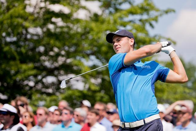 US open winner Martin Kaymer of Germany watches his shot during the BMW International Open golf tournament in Pulheim near Cologne, Germany, Thursday June 26, 2014. (AP Photo/dpa, Rolf Vennenbernd)