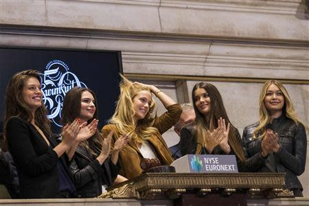 2014 Sports Illustrated Swimsuit Models Emily DiDonato, Natasha Barnard, Kate Bock, Emily Ratajkowski and Gigi Hadid (L-R) ring the closing bell at the New York Stock Exchange February 13, 2014. REUTERS/Brendan McDermid