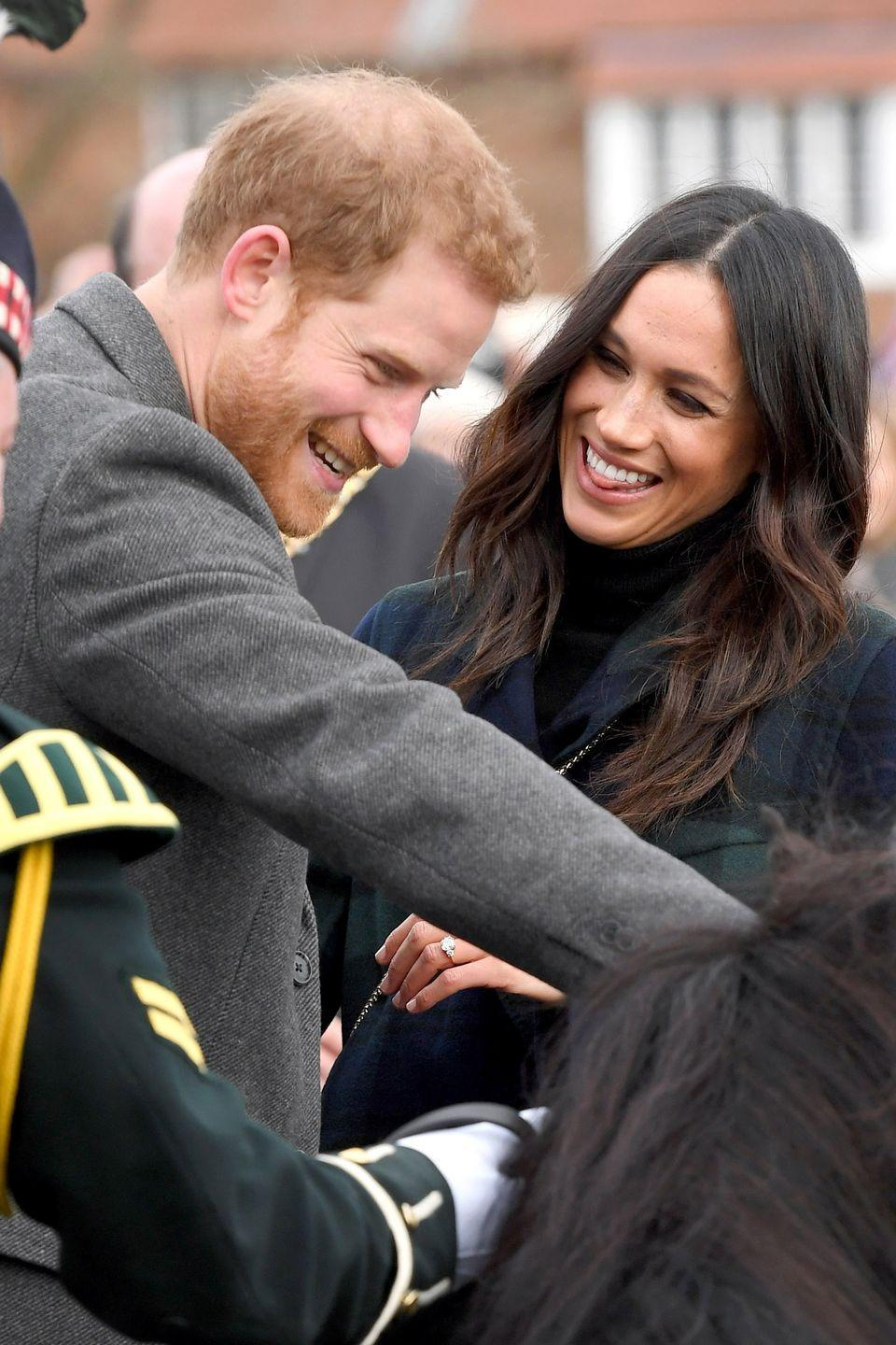 <p>While in Scotland, the pair appeared at the Edinburgh Castle, with Harry doing something hilarious to make the former <em>Suits</em> actress stick her tongue out in laughter.</p>