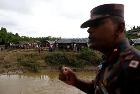 Lieutenant Colonel Monzurul Hassan Khan, a commanding officer of the Border Guards Bangladesh (BGB), speaks as Rohingya refugees stand outside their temporary shelters at no man's land between Bangladesh-Myanmar border, in Cox's Bazar, Bangladesh September 9, 2017. REUTERS/Danish Siddiqui