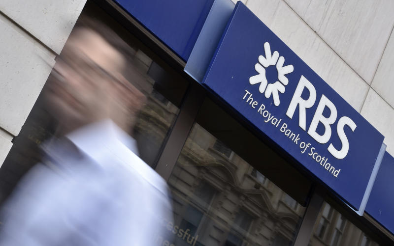 A man walks past a branch of The Royal Bank of Scotland (RBS) in central London August 27, 2014. REUTERS/Toby Melville/File Photo