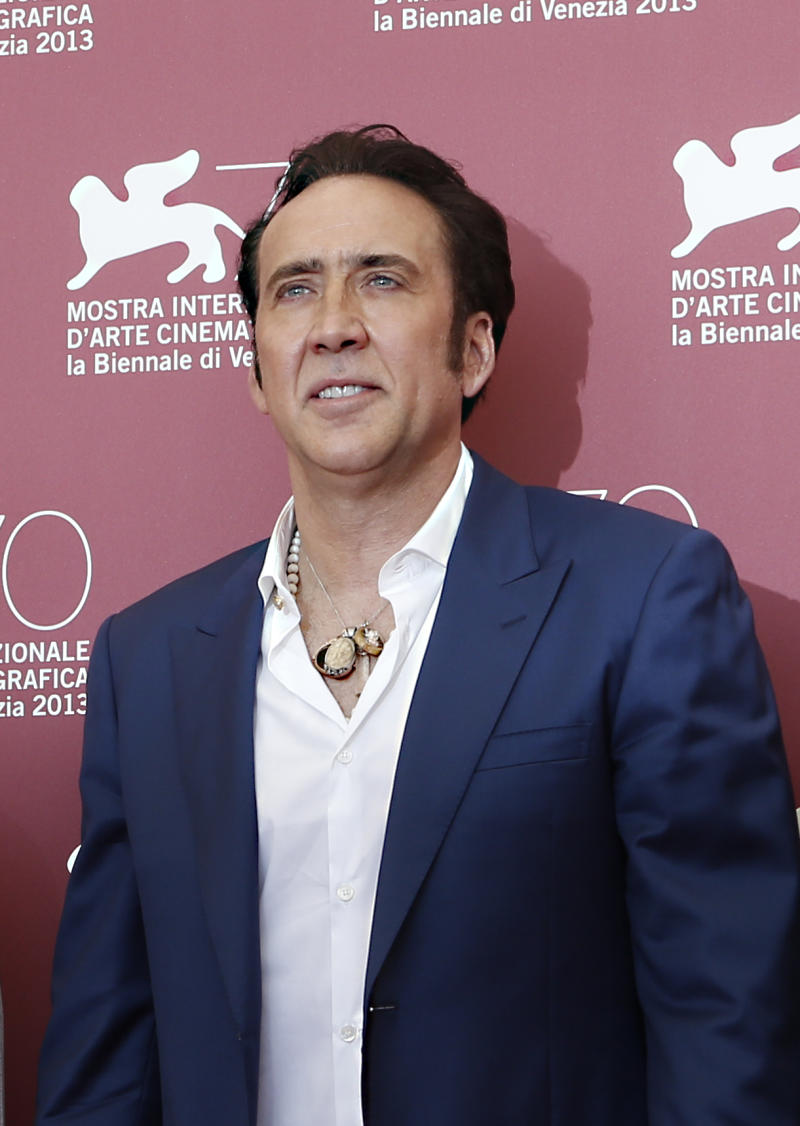 Actor Nicolas Cage poses for photographers at the photo call for the film Joe at the 70th edition of the Venice Film Festival held from Aug. 28 through Sept. 7, in Venice, Italy, Friday, Aug. 30, 2013. (AP Photo/David Azia)