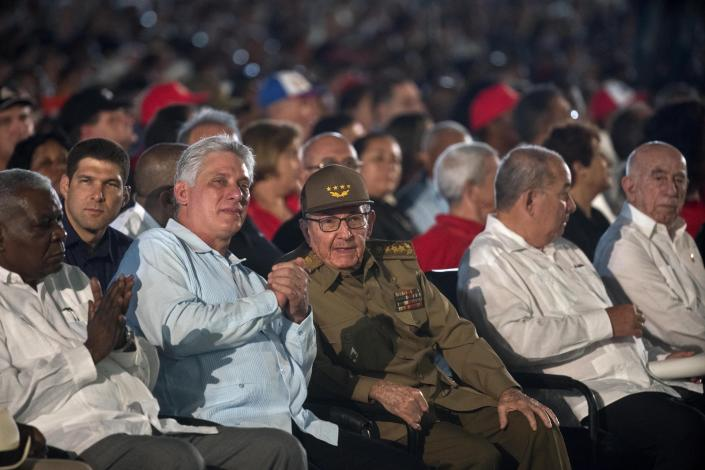 FILE - In this July 26, 2018 file photo, Cuba's former President Raul Castro, center, and President Miguel Diaz-Canel, second left, attend an event celebrating Revolution Day in Santiago, Cuba. On Monday, April 19, 2021, Cuba's Communist Party congress chose Díaz-Canel to be its leader, adding that post to the title of president he assumed in 2018, replacing his mentor Raul Castro and sealing a political dynasty that had held power since the 1959 revolution. (AP Photo/Ramon Espinosa, File)