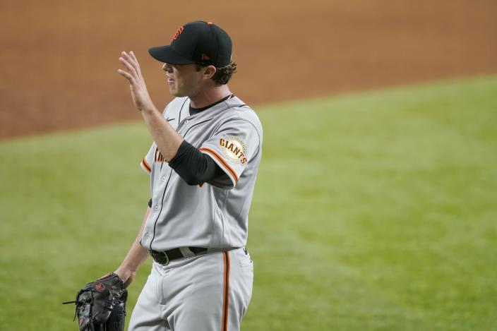 San Francisco Giants relief pitcher Sammy Long waves as he walks to the dugout after being pulled in the sixth inning of a baseball game in Arlington, Texas, Wednesday, June 9, 2021. Long made his major league debut in the game. (AP Photo/Tony Gutierrez)