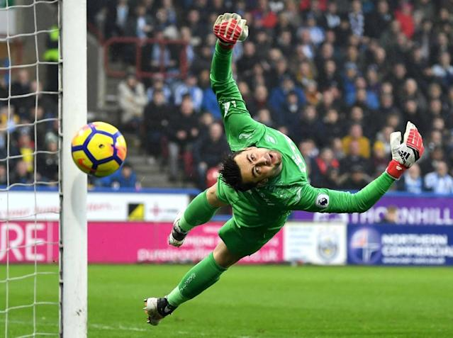 Swansea survive 80 minutes with 10 men to earn draw at Huddersfield