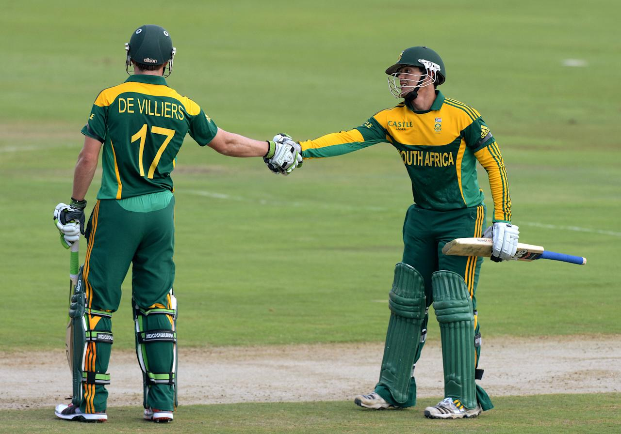 CENTURION, SOUTH AFRICA - DECEMBER 11: AB de Villiers and Quinton de Kock of South Africa celebrate their 150 run partnership during the 3rd Momentum ODI match between South Africa and India at SuperSport Park on December 11, 2013 in Centurion, South Africa. (Photo by Duif du Toit/Gallo Images/Getty Images)