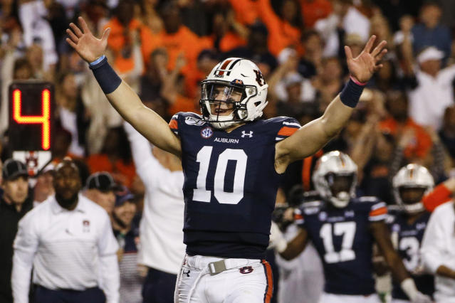 "Auburn quarterback <a class=""link rapid-noclick-resp"" href=""/ncaaf/players/299270/"" data-ylk=""slk:Bo Nix"">Bo Nix</a> reacts after a penalty gave Auburn a first down and secured the win over Alabama during the second half of an NCAA college football game Saturday, Nov. 30, 2019, in Auburn, Ala. Auburn won 48-45. (AP Photo/Butch Dill)"