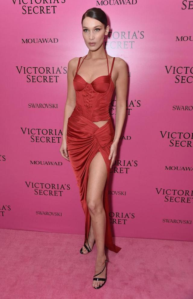 Bella Hadid wearing a bustier style dress on the red carpet for the Victoria's Secret Fashion show after party. (Photo: Getty Images)