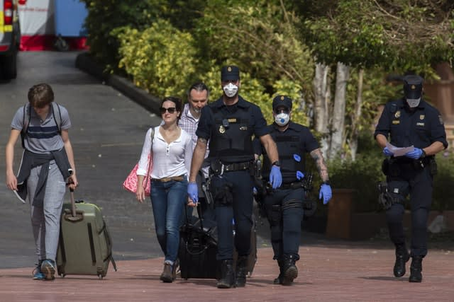 Hotel guests being escorted by police