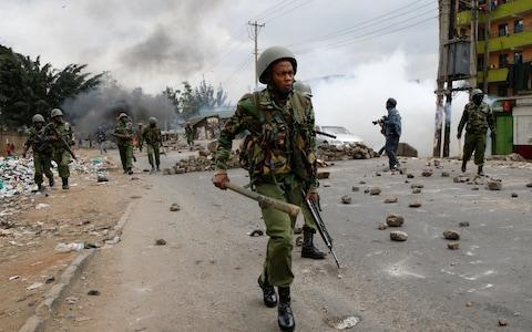 <span>Anti riot policemen deploy to disperse protesters in Mathare, in Nairobi</span> <span>Credit: REUTERS </span>