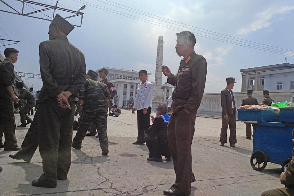 <p>Officials stand around in the centre. Although North Korea isn't technically a Communist state (it follows the ideologies of the 'juche' way of living), it follows a lot of patterns from previous Communist leaders. (Getty) </p>