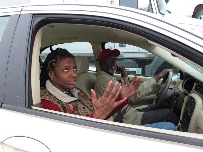 Sandra Lockhart Roberts, left, and Lee Pointer sit in their car in a massive traffic jam on Interstate 40, Tuesday, March 4, 2014 in West Memphis, Ark. They were headed from Memphis to West Memphis to make a payment on their car note when they got stuck in the traffic jam. (AP Photo/Adrian Sainz)