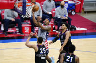 Washington Wizards' Bradley Beal (3) goes up for a shot against Philadelphia 76ers' Ben Simmons (25) and Tobias Harris (12) during the second half of Game 2 in a first-round NBA basketball playoff series, Wednesday, May 26, 2021, in Philadelphia. (AP Photo/Matt Slocum)