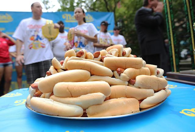 NEW YORK, NY - JULY 03: Hot dogs sit on a plate during the Nathan's Famous Fourth of July International Hot Dog Eating Contest weigh-in ceremony on July 3, 2013 in the Brooklyn borough of New York City. The annual hot dog eating event is expected to draw up to 40,000 fans on July 4, in the Coney Island section of Brooklyn. (Photo by Mario Tama/Getty Images)