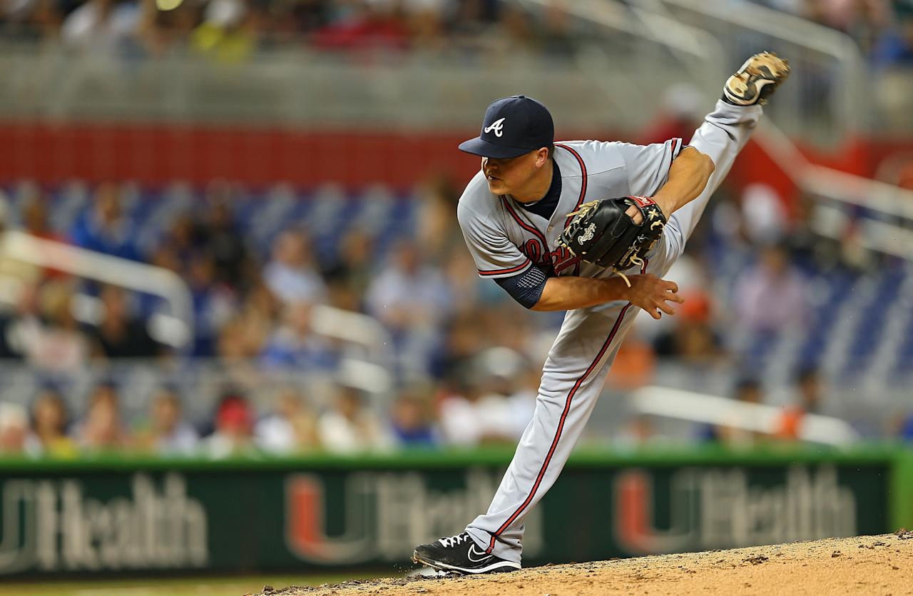 MIAMI, FL - SEPTEMBER 19:  Kris Medlen #54 of the Atlanta Braves of the Atlanta Braves pitches during a game against the Miami Marlins at Marlins Park on September 19, 2012 in Miami, Florida.  (Photo by Mike Ehrmann/Getty Images)