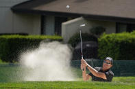 Phil Mickelson follow his shot out of a bunker up to the second green of the Silverado Resort North Course during the final round of the Fortinet Championship PGA golf tournament Sunday, Sept. 19, 2021, in Napa, Calif. (AP Photo/Eric Risberg)