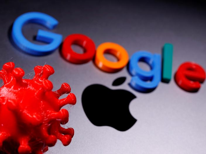 FILE PHOTO: 3D printed coronavirus model and Google logo are placed near an Apple Macbook Pro in this illustration taken April 12, 2020. REUTERS/Dado Ruvic/Illustration/File Photo
