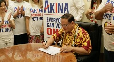 Keli'i Akina signs his nomination papers for re-election as Trustee At-Large for the Office of Hawaiian Affairs.