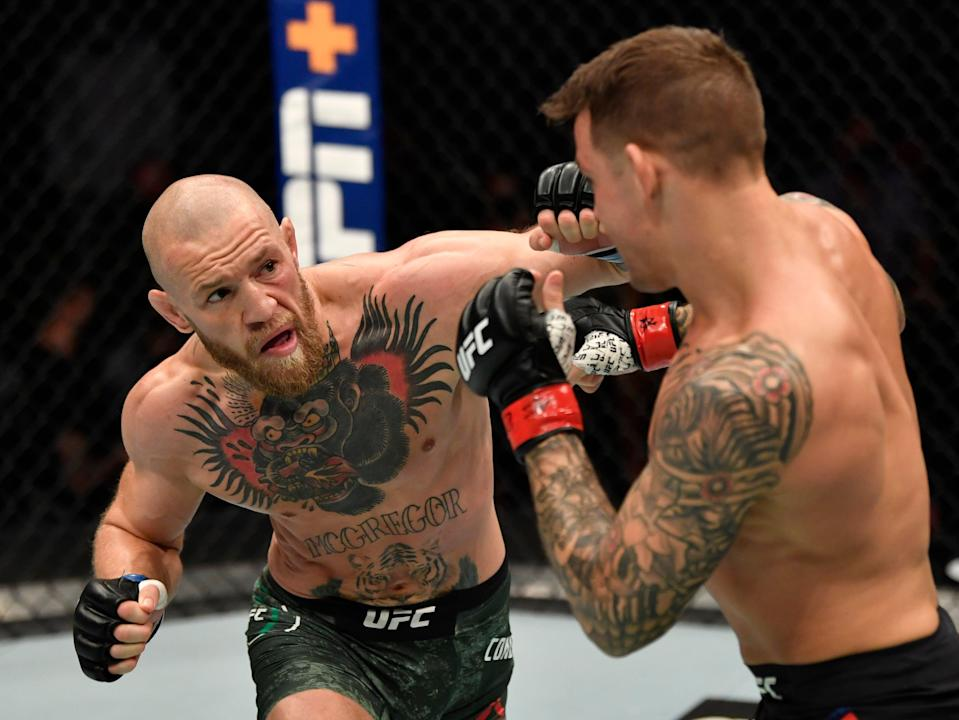 Conor McGregor (left) and Dustin Poirier in their second fight, in January (Zuffa LLC via Getty Images)