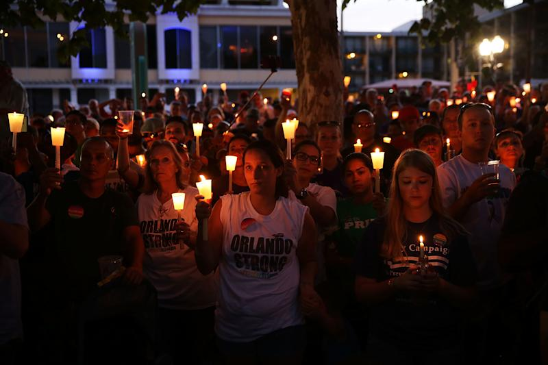 People attend a memorial service on June 19, 2016, in Orlando, Florida. (Spencer Platt via Getty Images)