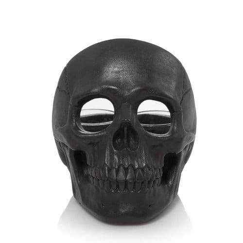 <p>Put a candle inside this <span>Skull Tea Light Candle Holder</span> ($18), and we promise you'll get chills when you see it lit up.</p>