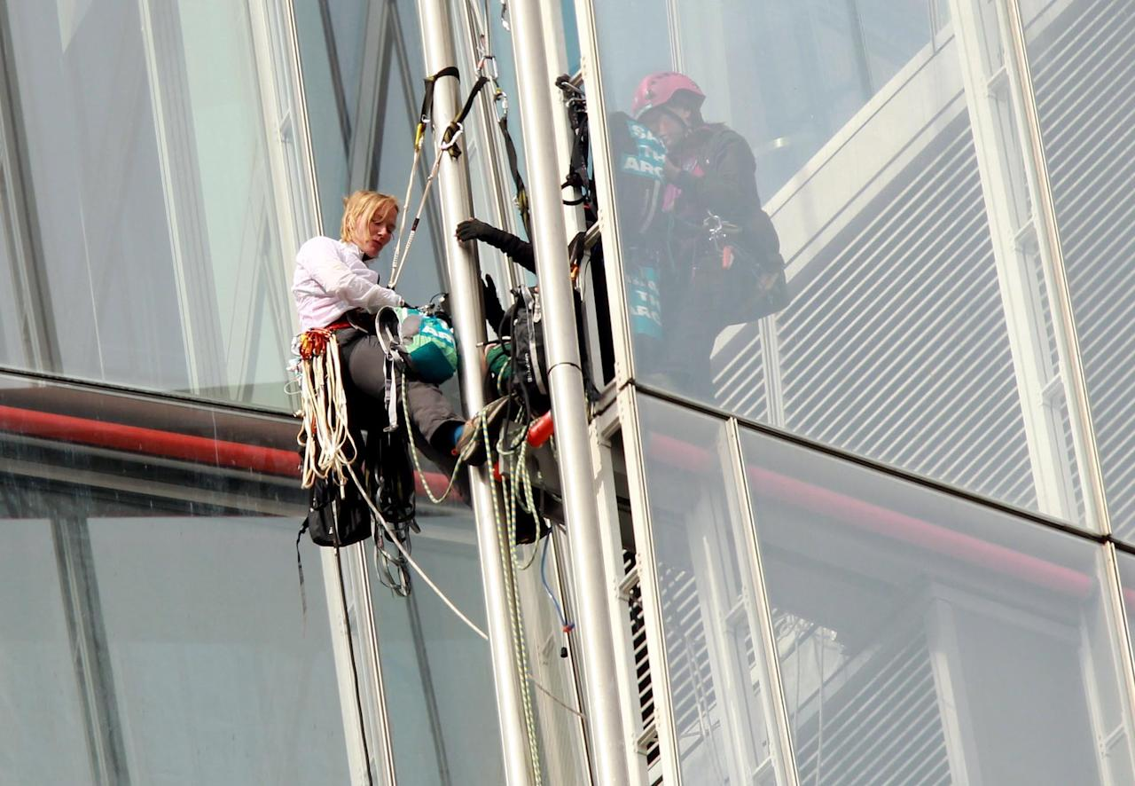 Greenpeace activists, part of a group of six women, as they climb the Shard in central London, in protest at drilling in the Arctic.