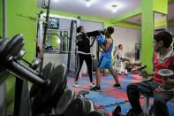 Sabah Saqr, an Egyptian boxing coach challenges social boundaries by training men, is seen during a training session at the gym, in Bani Swief