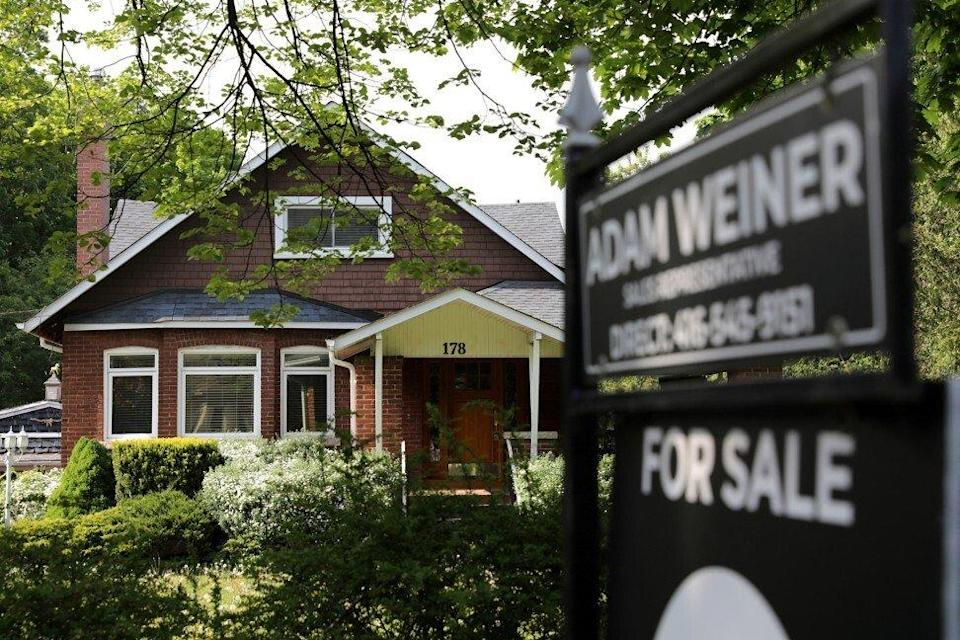 A realtor's sign outside a house for sale in Toronto on May 20, 2021. Photo: Reuters.