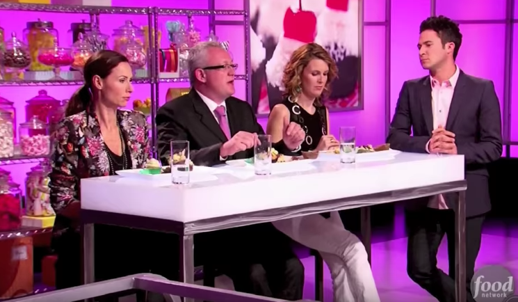 """<p>Any show that can nab a magician — and then a member of the <em>Mean Girls</em> cast — as host is special. The <a href=""""https://www.delish.com/restaurants/g4157/visit-every-winning-bakery-on-cupcake-wars/"""" rel=""""nofollow noopener"""" target=""""_blank"""" data-ylk=""""slk:cupcake-making competition"""" class=""""link rapid-noclick-resp"""">cupcake-making competition</a> is an hour respite from the real world, all sugar, a little spice (the losing bakers' reactions are golden), and everything nice.<br></p>"""