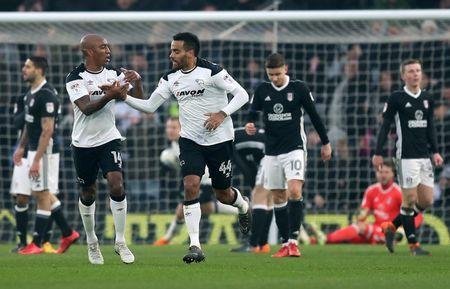 Soccer Football - Championship - Derby County vs Fulham - Pride Park, Derby, Britain - March 3, 2018 Derby County's Tom Huddlestone celebrates scoring their first goal with Andre Wisdom Action Images/John Clifton