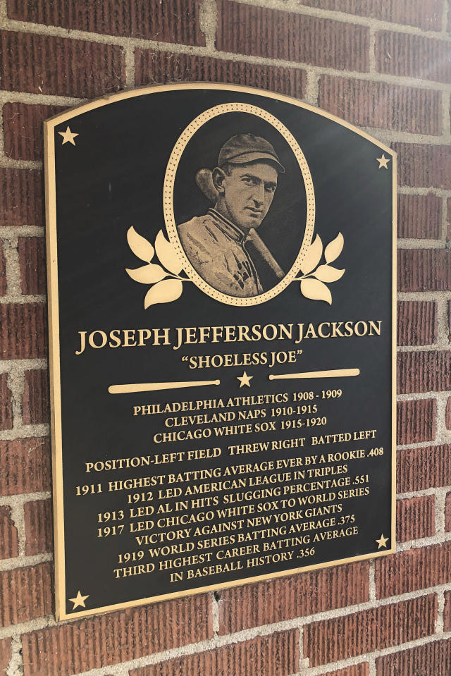 In this Sept. 29, 2019, photo, a plaque outside the Shoeless Joe Jackson Museum is shown in Greenville, S.C. (AP Photo/Paul Newberry)