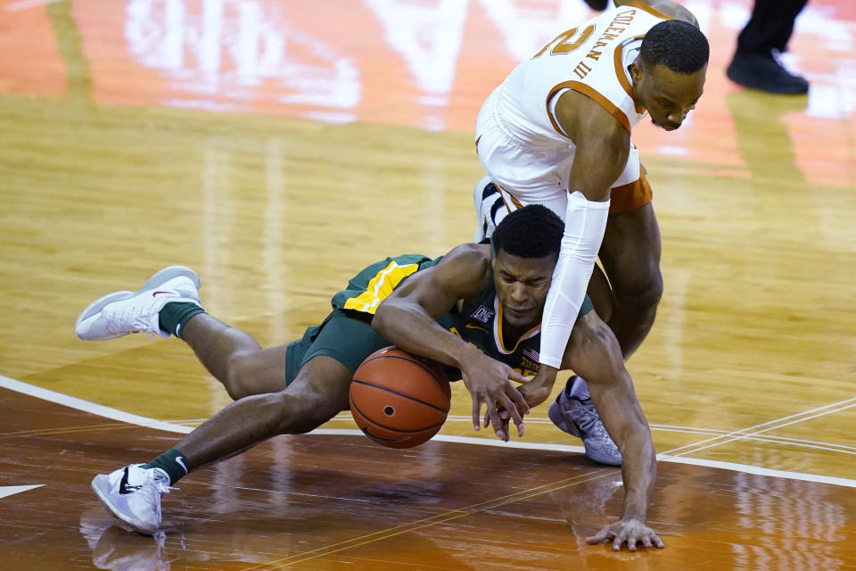 Baylor guard Jared Butler, left, and Texas guard Matt Coleman III (2) vie for the ball during the first half of an NCAA college basketball game Tuesday, Feb. 2, 2021, in Austin, Texas. (AP Photo/Eric Gay)