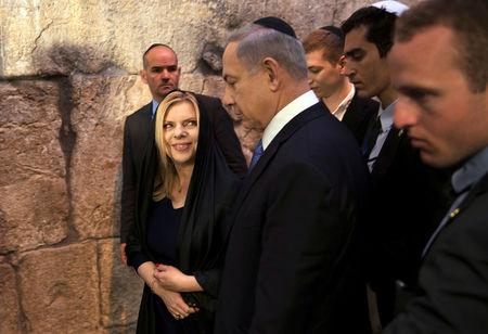 FILE PHOTO: Israel's Prime Minister Benjamin Netanyahu (C) leaves with his wife Sara after he delivered a statement to the media at the Western Wall, Judaism's holiest prayer site, in Jerusalem's Old City March 18, 2015. REUTERS/Ronen Zvulun/File Photo