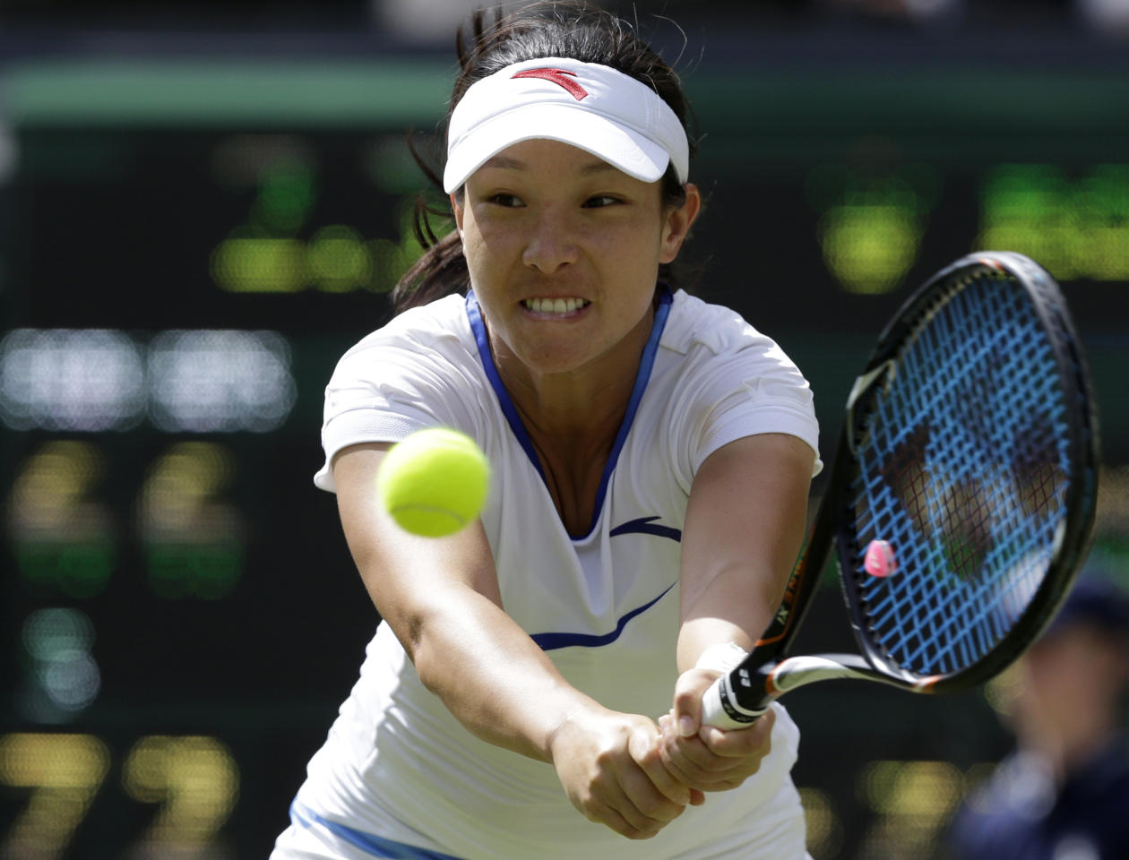 Zheng Jie of China plays a return to Serena Williams of the United States during a third round women's singles match at the All England Lawn Tennis Championships at Wimbledon, England, Saturday, June 30, 2012. (AP Photo/Anja Niedringhaus)