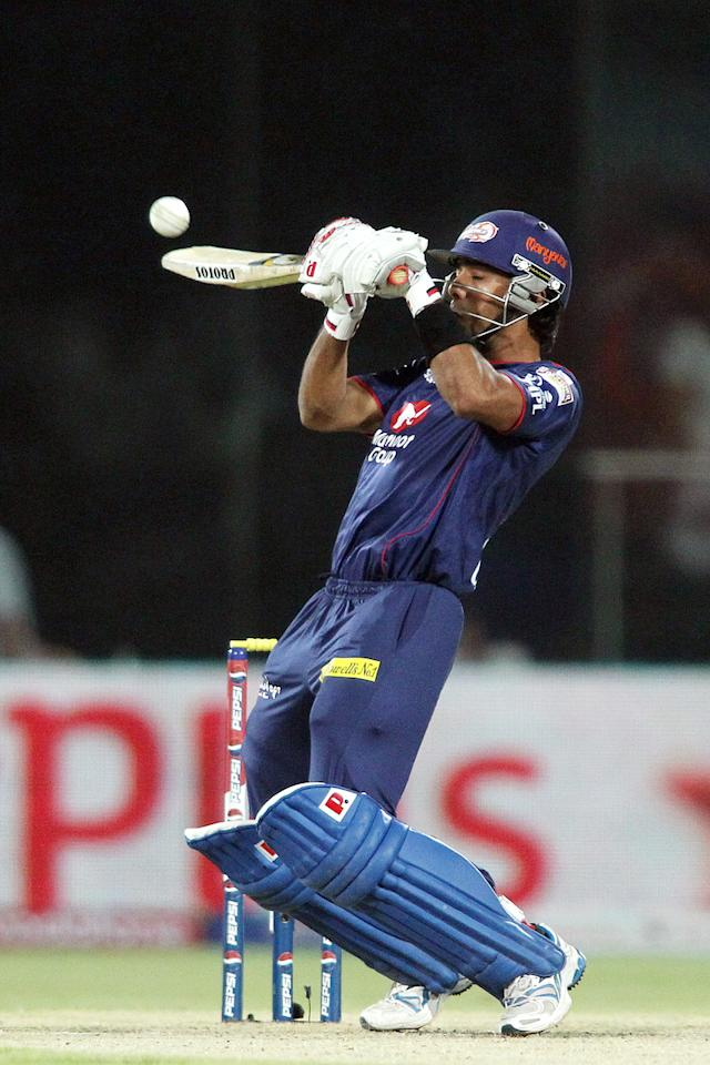 Unmukt Chand of Delhi Daredevils upper a delivery to the boundary during match 57 of the Pepsi Indian Premier League between Delhi Daredevils and the Royal Challengers Bangalore held at the Feroz Shah Kotla Stadium, Delhi on the 10th May 2013.(BCCI)