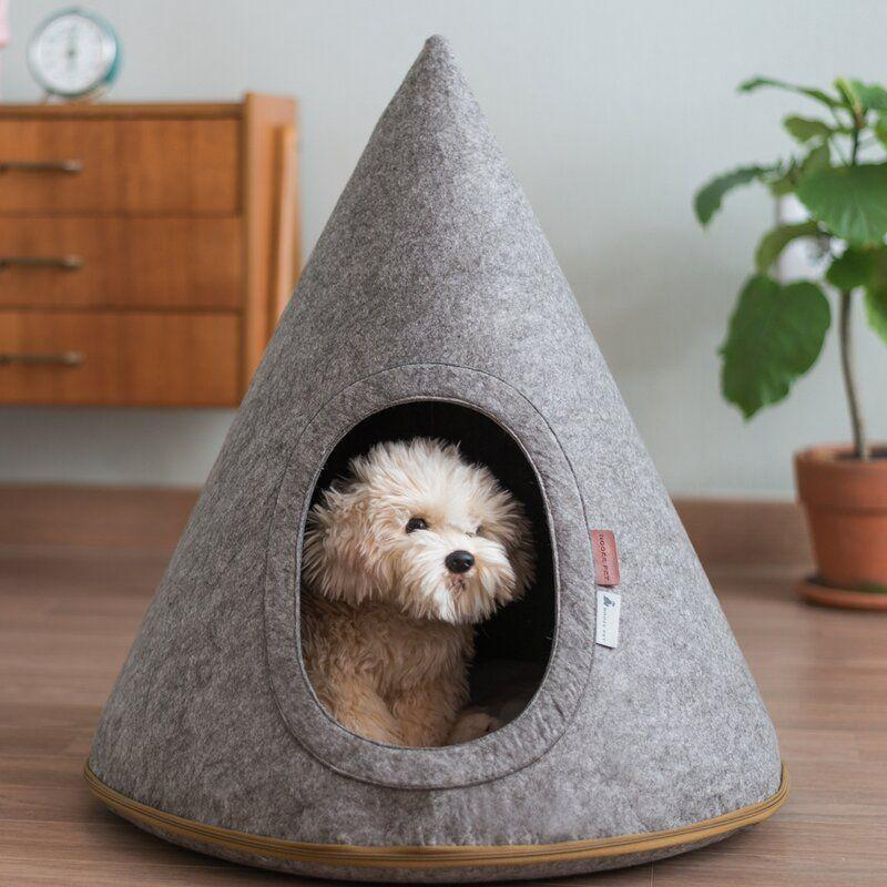 """<p><strong>Tucker Murphy Pet</strong></p><p>wayfair.com</p><p><strong>$77.90</strong></p><p><a href=""""https://go.redirectingat.com?id=74968X1596630&url=https%3A%2F%2Fwww.wayfair.com%2Fpet%2Fpdp%2Ftucker-murphy-pet-boisvert-felt-pet-cave-toby-hooded-dog-bed-w000352536.html&sref=https%3A%2F%2Fwww.marieclaire.com%2Fhome%2Fg24851290%2Fbest-dog-gifts%2F"""" rel=""""nofollow noopener"""" target=""""_blank"""" data-ylk=""""slk:SHOP IT"""" class=""""link rapid-noclick-resp"""">SHOP IT</a></p><p>Ever wished you had access to a plush, cozy cave where you could go and hide when the world got too much? Well, you can't—but you <em>can </em>provide that for your pup. Bonus: It's really, really cute.</p>"""