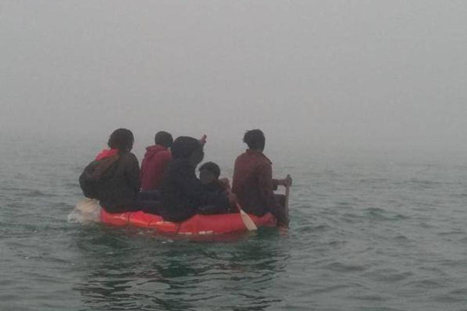 A group of people, including a child, amid more crossings activity in the English Channel (PA)