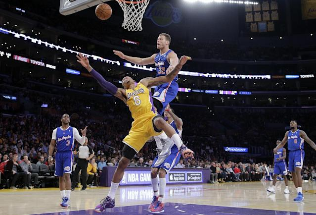 Los Angeles Clippers' Blake Griffin, top, fouls Los Angeles Lakers' Kent Bazemore during the first half of an NBA basketball game on Thursday, March 6, 2014, in Los Angeles. (AP Photo/Jae C. Hong)