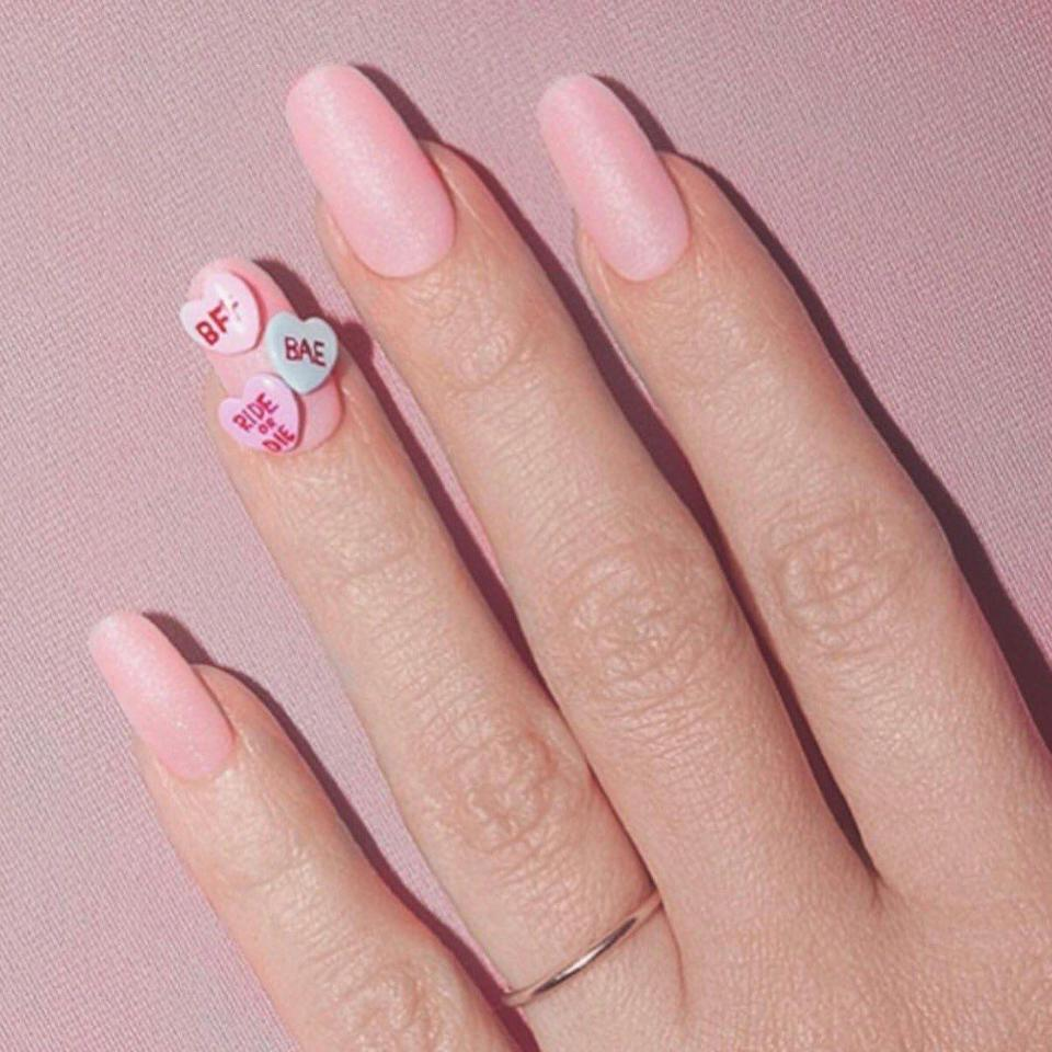 <p>For her heart-themed photoshoot for her new Kimoji fragrance, Kimmy added tiny (faux) candy pieces to her pastel pink nails. Major V Day inspo. </p>