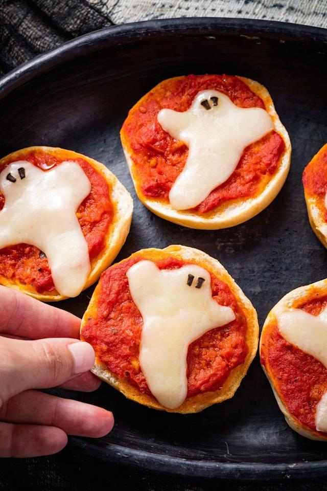 """<p>The scariest thing about these pizza bagels is how fast we're going to eat them.</p><p>Get the <a href=""""https://www.delish.com/uk/cooking/recipes/a29351932/ghost-pizza-bagels-recipe/"""" target=""""_blank"""">Ghost Pizza Bagels</a> recipe.</p>"""