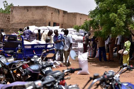 Displaced people receive humanitarian aid in the city of Kaya, Burkina Faso May 16, 2019. REUTERS/Anne Mimault